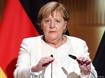 Merkel nimmt Russland in Schutz  - Halle (Saale), APA/AFP/POOL