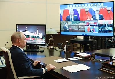 Putin un Xi beim Video-Conferencing  - Novo-Ogaryovo, APA/SPUTNIK
